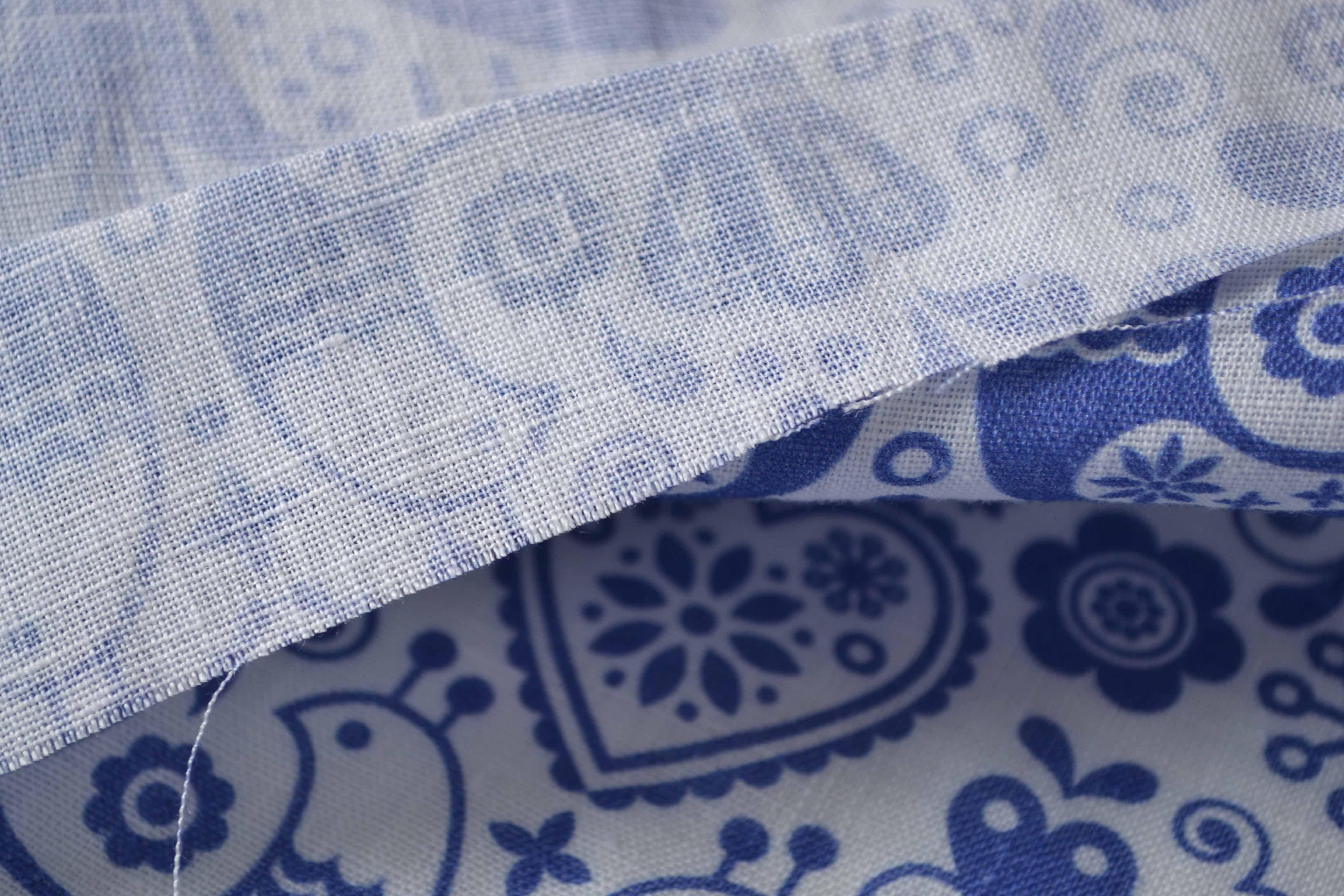 látka-ľan-premium-vtáčiky-modré-na-bielom